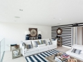 Black-and-white-striped-accent-wall-works-with-a-wide-range-of-styles