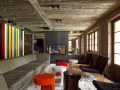 Colorful-accent-wall-brings-contemporary-appeal-to-a-rustic-living-room