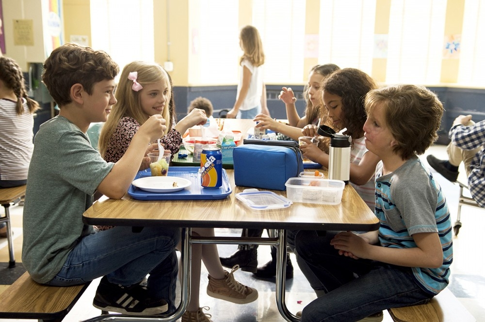 "From L to R: Noah Jupe as ""Jack Will,\"" Elle McKinnon as \""Charlotte,\"" Mille Davis as \""Summer\"" and Jacob Tremblay as \""Auggie\"" in WONDER."