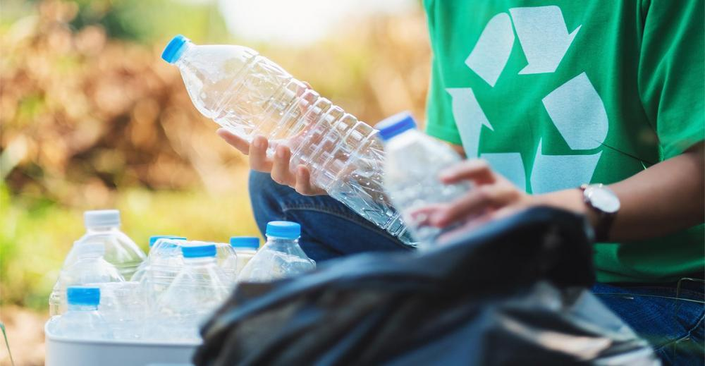 Nextek-Recycling-Bottles-Hand-AdobeStock_320996786