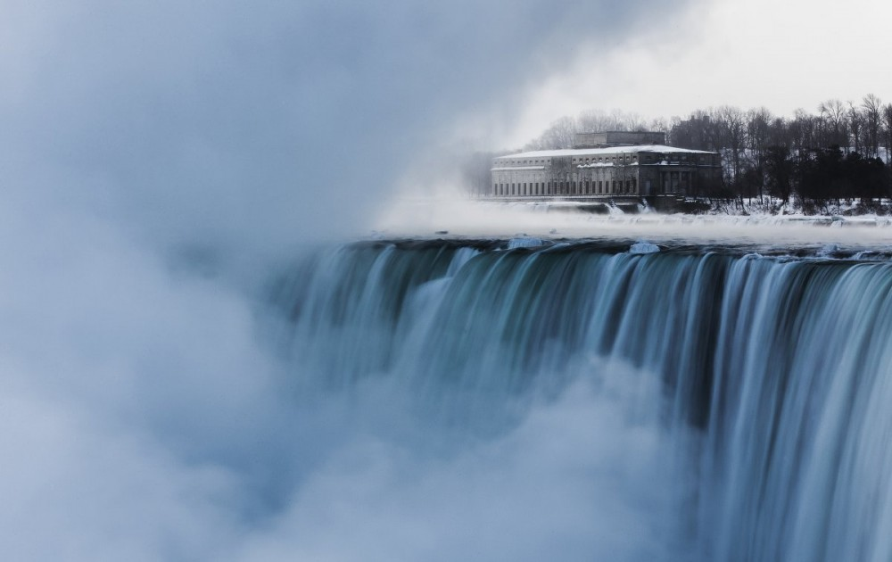 an-old-hydro-building-is-seen-behind-niagara-falls-during-sub-freezing-temperatures-in-niagara-falls-ontario.jpg