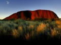 the-sun-sets-on-ayers-rock-one-of-australias-major-tourist-destinations-attracting-400000-visitors-every-year.jpg